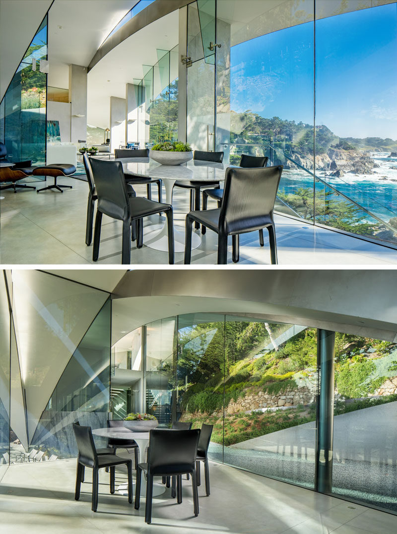 This modern dining room has views of both sides of the house through tall floor-to-ceiling windows.