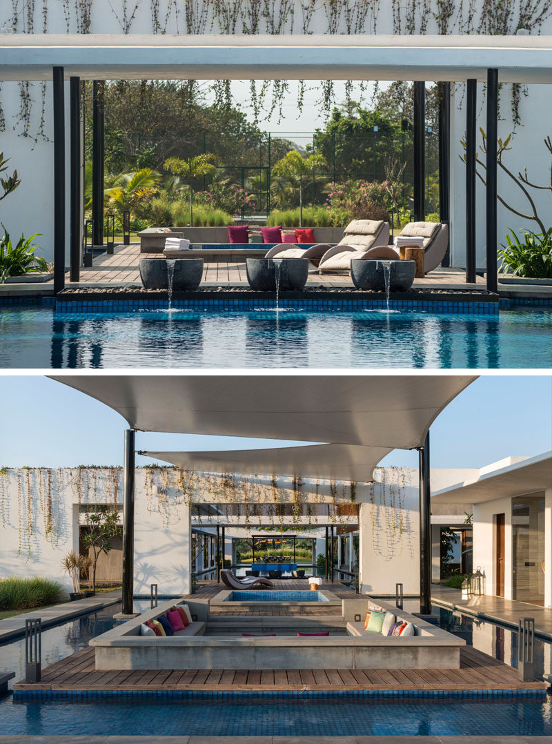 This modern house has an outdoor hot-tub and sunken lounge area, that's surrounded by a water feature.