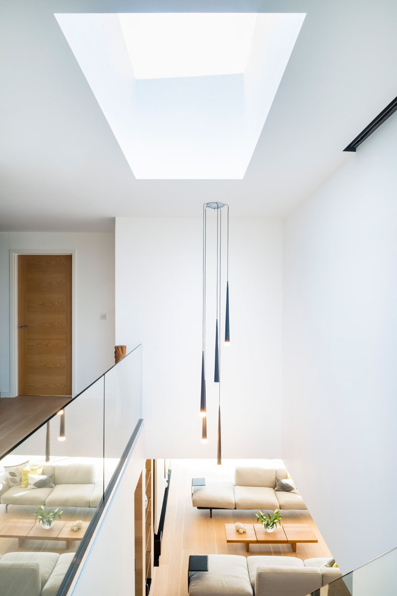 At the top of these modern stairs is a skylight that fills the space below with natural light.