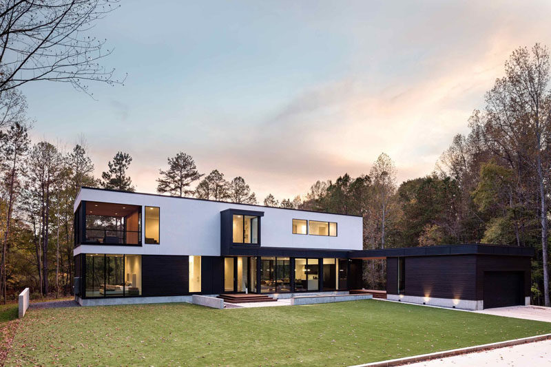 This New Contemporary House Surrounded By Trees Overlooks A Woodland Pond