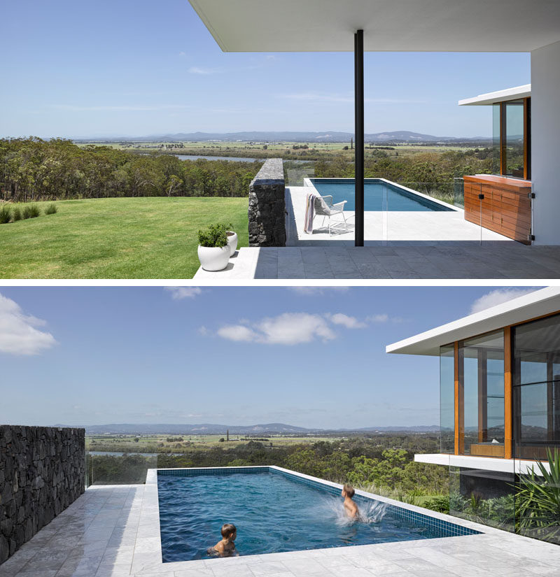 This modern house has a covered outdoor area that provides access to the swimming pool, that has an amazing view of the landscape and mountains in the distance.