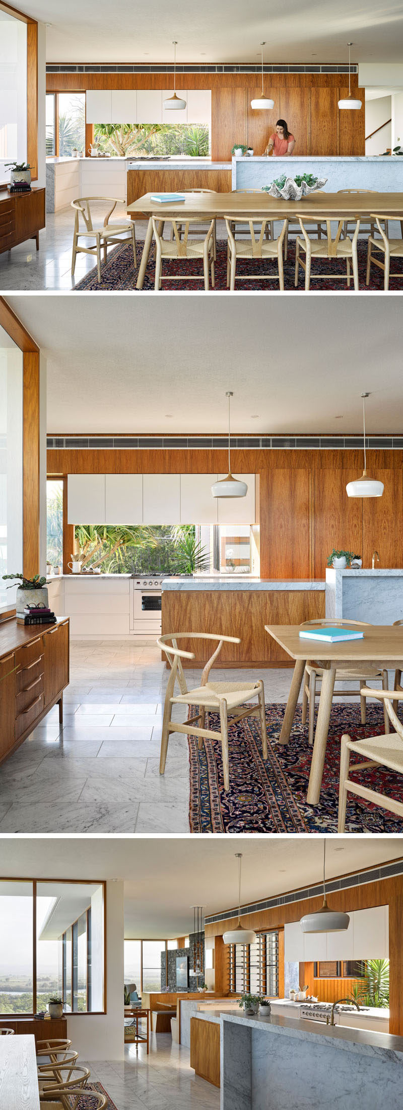 This modern house features a kitchen with wood cabinets and marble countertops.