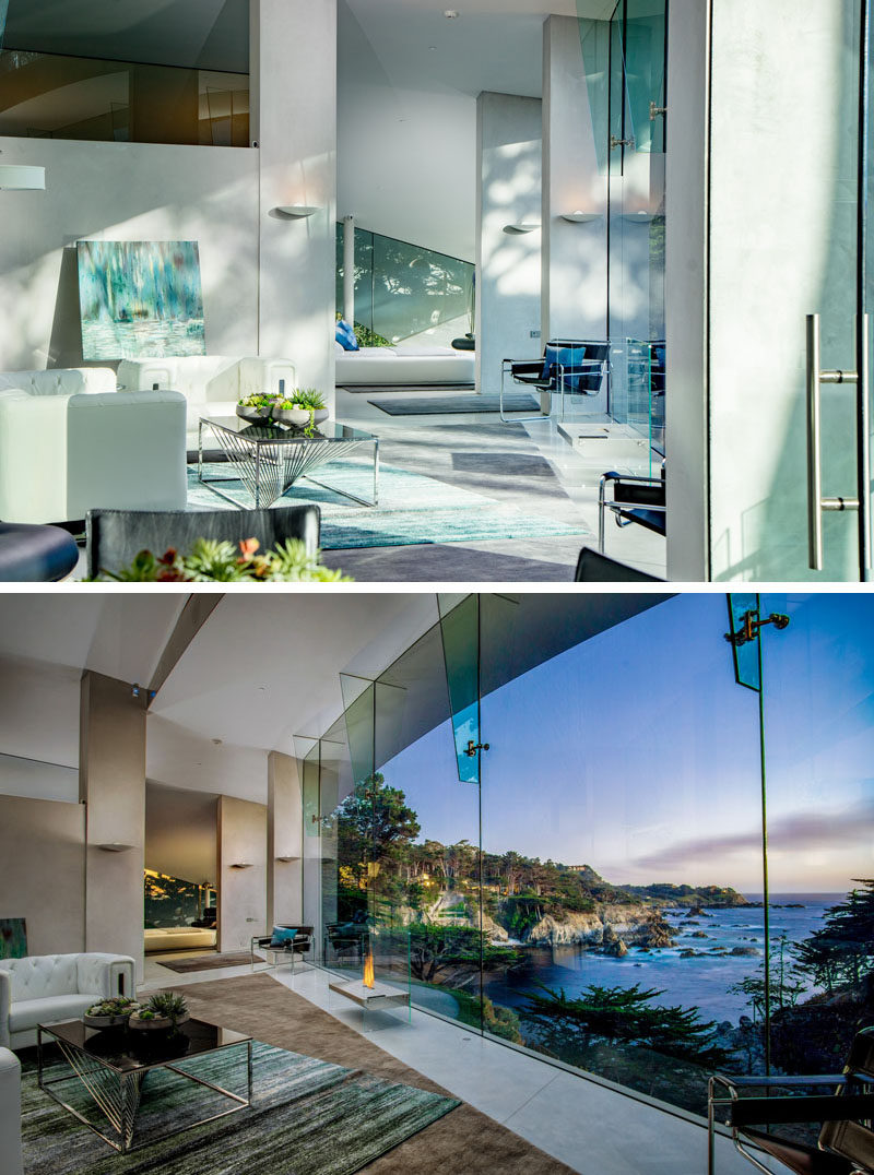 Walls of glass provide seamless views of the ocean and fills this modern living room with natural light.