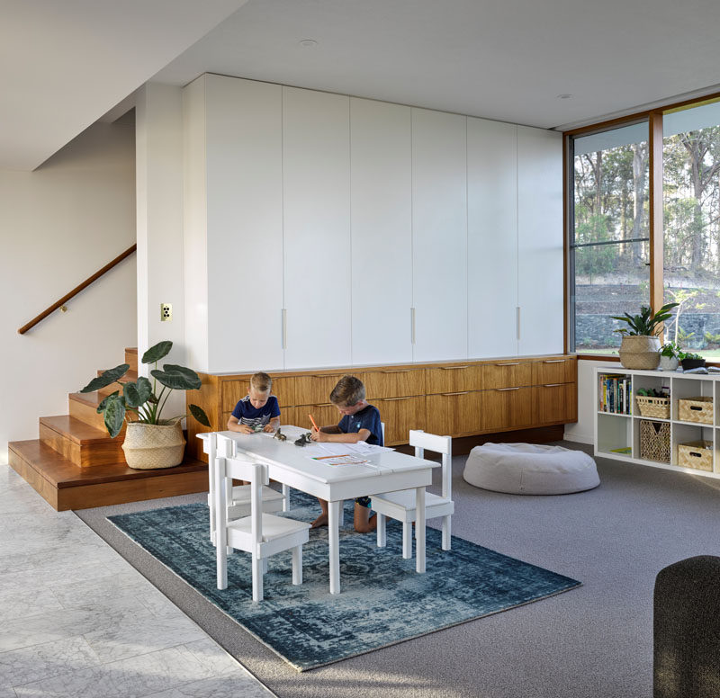 This modern house has a rumpus space or play room for the kids, however it will also evolve into an area where the children can be home schooled.