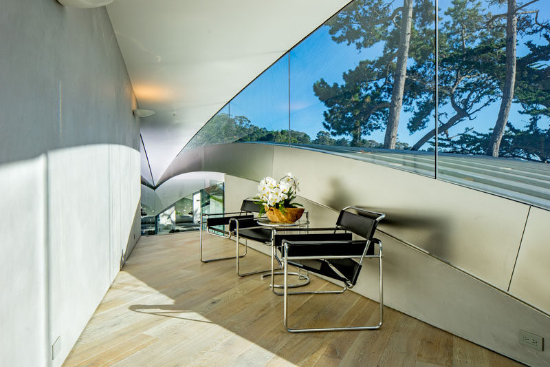 A small area at the top of this sculptural and modern house has been made into a small sitting room.