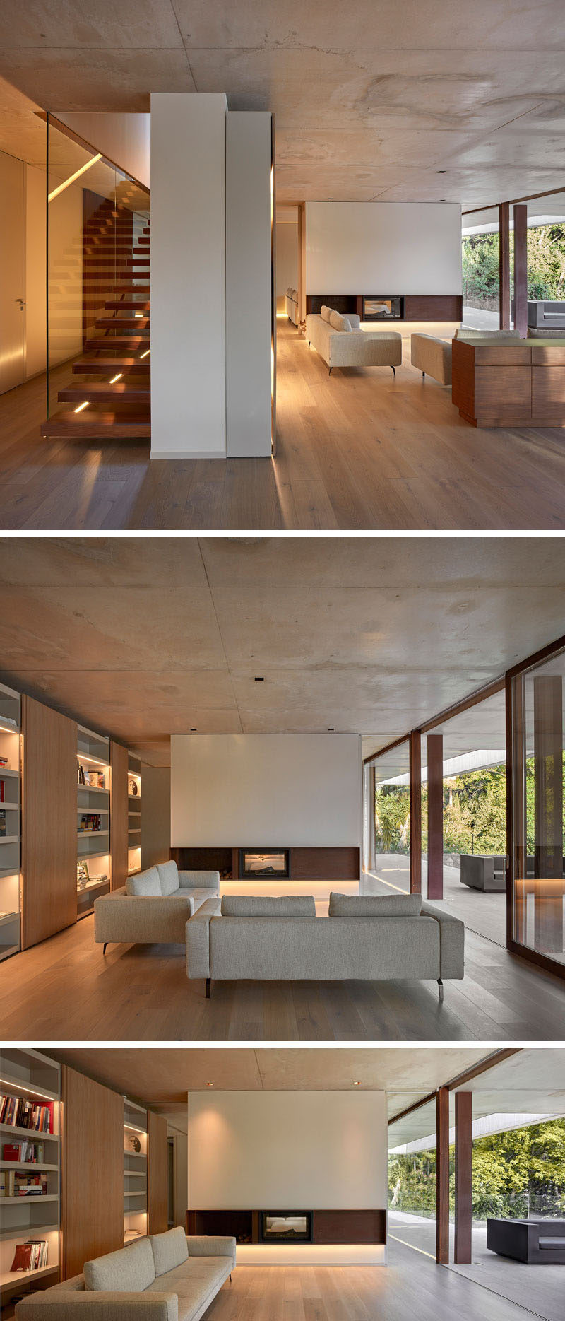 Stepping inside this modern house, the living room with wood flooring and a concrete ceiling, has a minimalist fireplace and a wall of shelving with highlighted sections to display personal items.