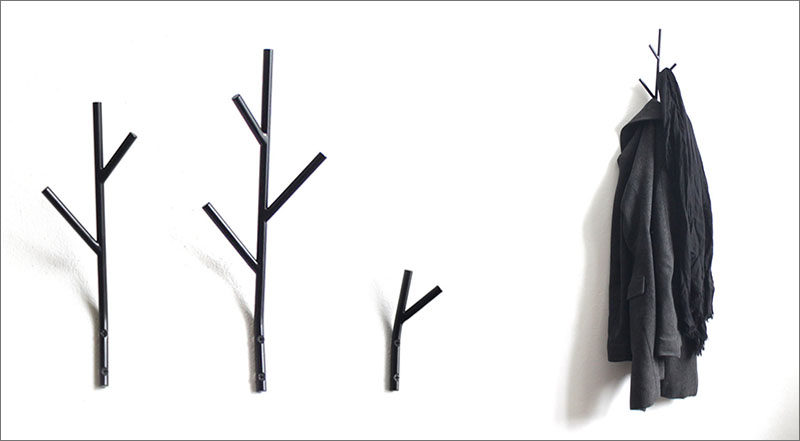 Minimalist, twig shaped hooks made from metal add a touch of natural whimsy to your walls.