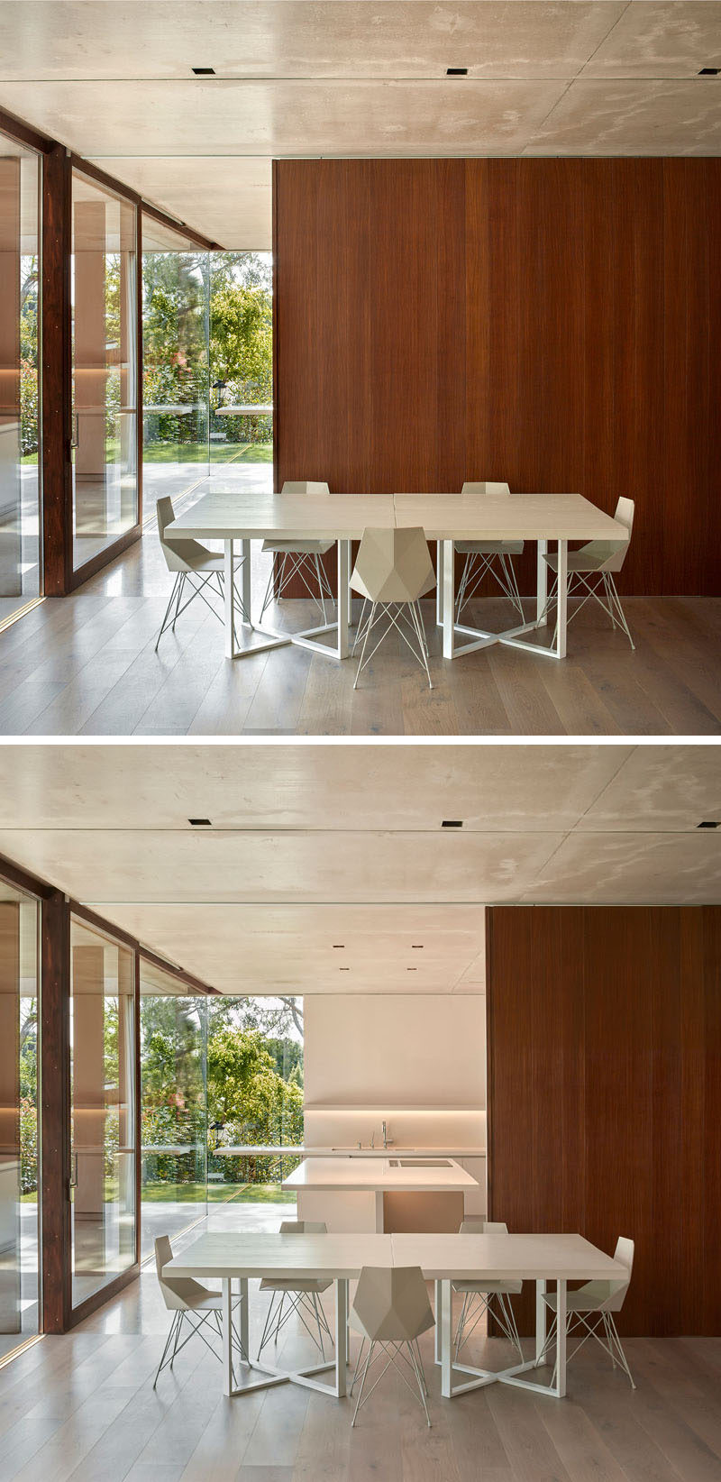 This dining room is minimal in its design with white table and chairs, while a wood wall slides open to reveal the kitchen behind it.