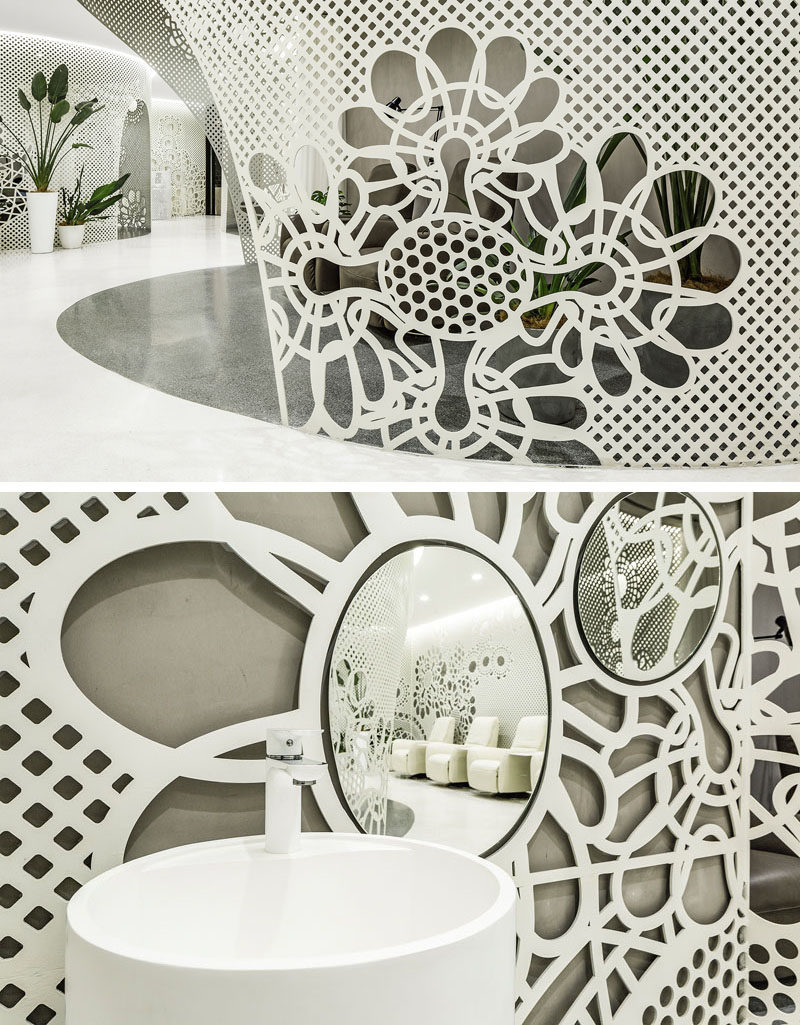 The delicate lace-like patterns featured in this modern nail salon, are created by laser-cutting 6mm steel plates that are then curved where required.