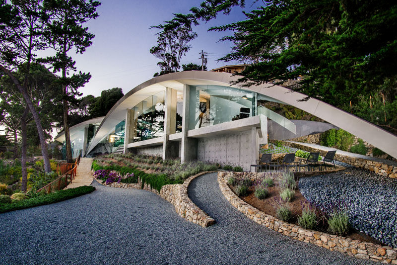 This sculptural house combines stainless steel concrete for Glass houses for sale in california