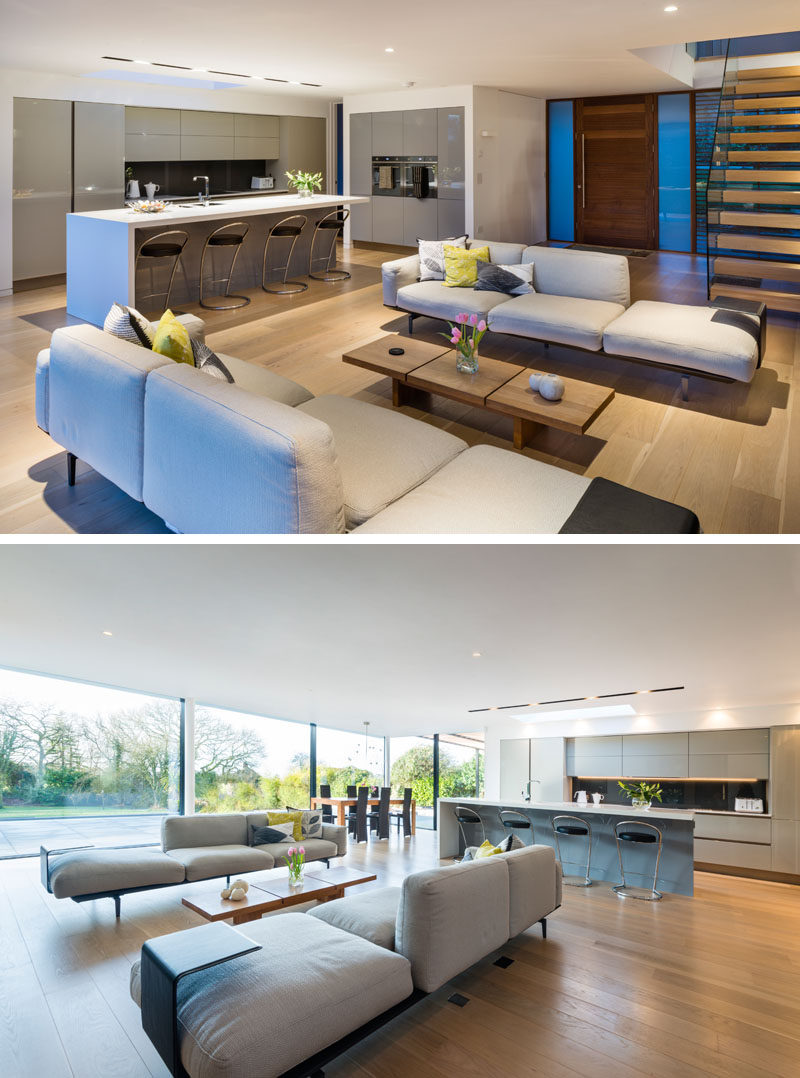 This modern house has an open floor plan on the main floor with the living room, dining room and kitchen all sharing the same space.