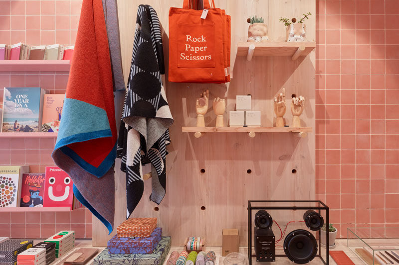 This modern retail store has a variety of shelving designs, like this simple wood pegboard wall shelf.
