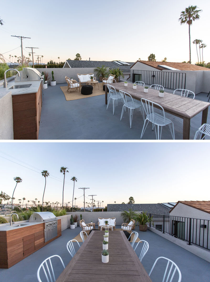 The roof of this modern house has been turned into a rooftop deck with a built-in outdoor kitchen with bbq, a lounge area and an dining area.