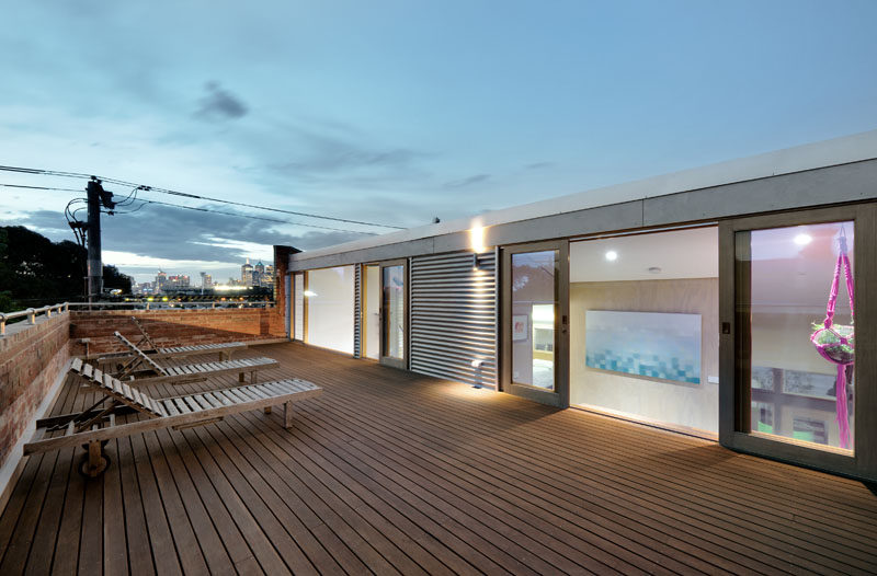 This modern converted warehouse has access to a roof deck that has views of the city.