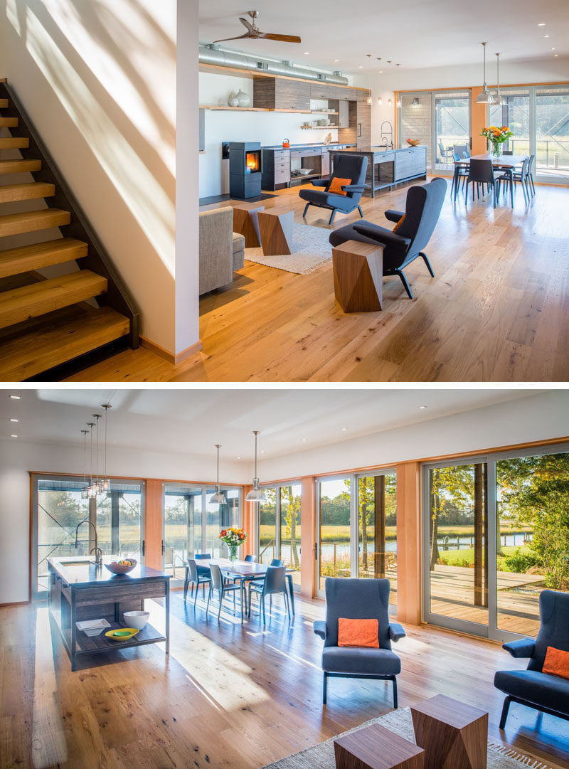 Inside this modern house, the interior is bright and airy. The main living, dining and kitchen area is open plan, with sliding glass doors on two sides of the room.