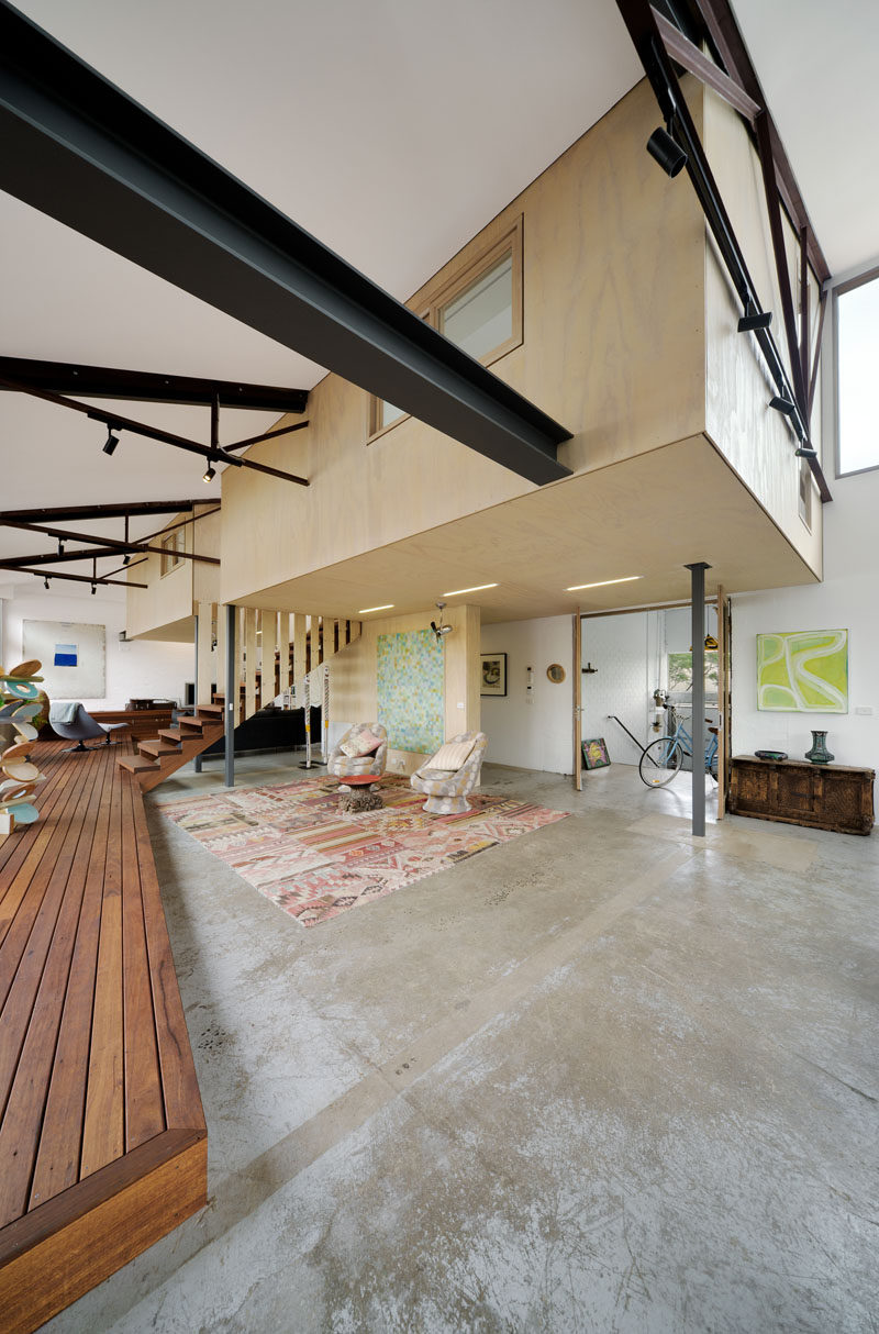 Throughout the main living level of this converted warehouse, the existing warehouse floor slab was kept, partially due to restricted site access, but also for its inherent embodied energy.