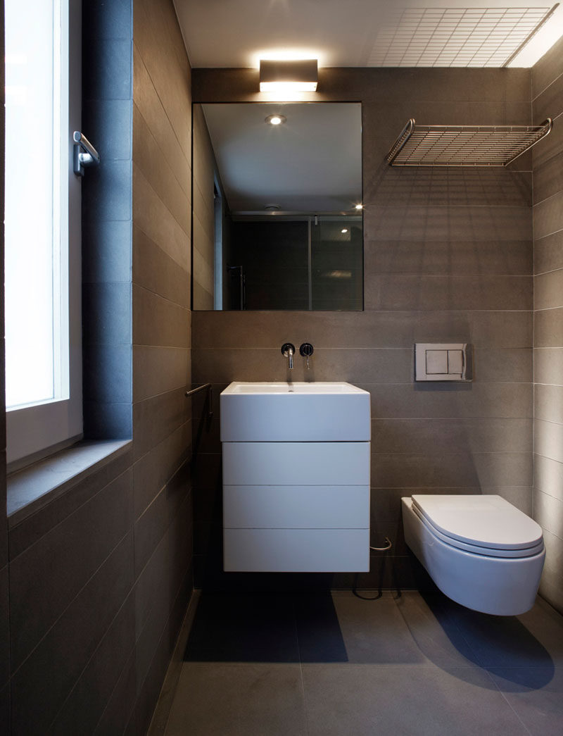 This small and modern bathroom features Pietra Serena Italian sandstone walls and floors.
