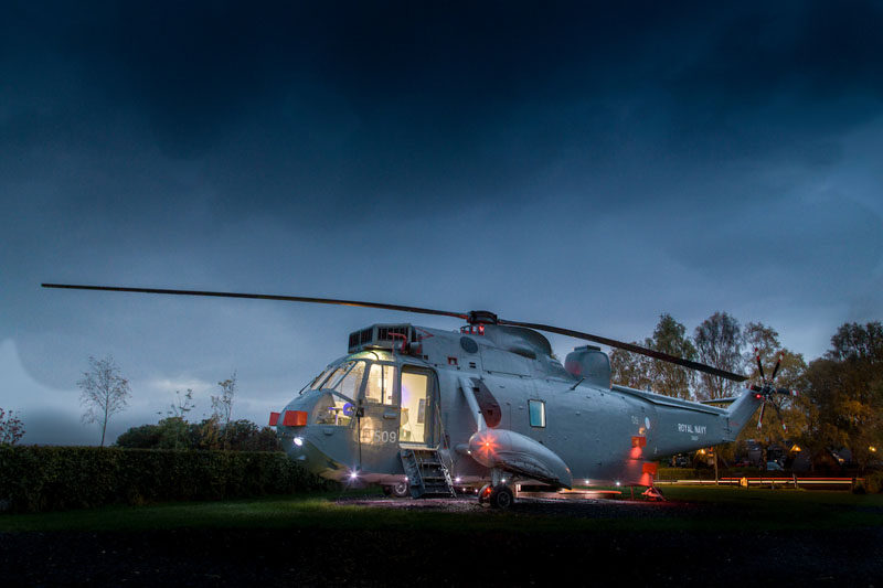The team at Mains Farm in Stirling, Scotland, thought outside the box and invested in a decommissioned Royal Navy ZA127 Sea King Helicopter and turned it into a fun glamping destination, where you can sleep inside the helicopter.