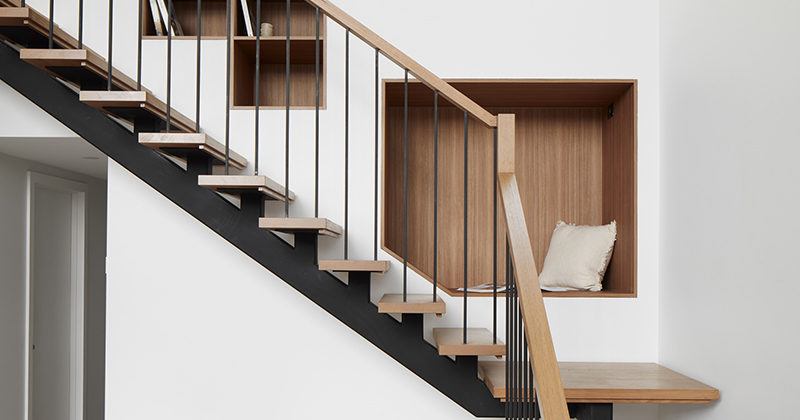 Built-In Seating And Shelving Were Included In The Wall Alongside This Staircase
