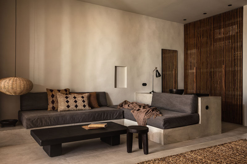 This contemporary hotel room in Greece features a couch that's been built into the room. #HotelRoom #Greece #Couch #BuiltInCouch #InteriorDesign