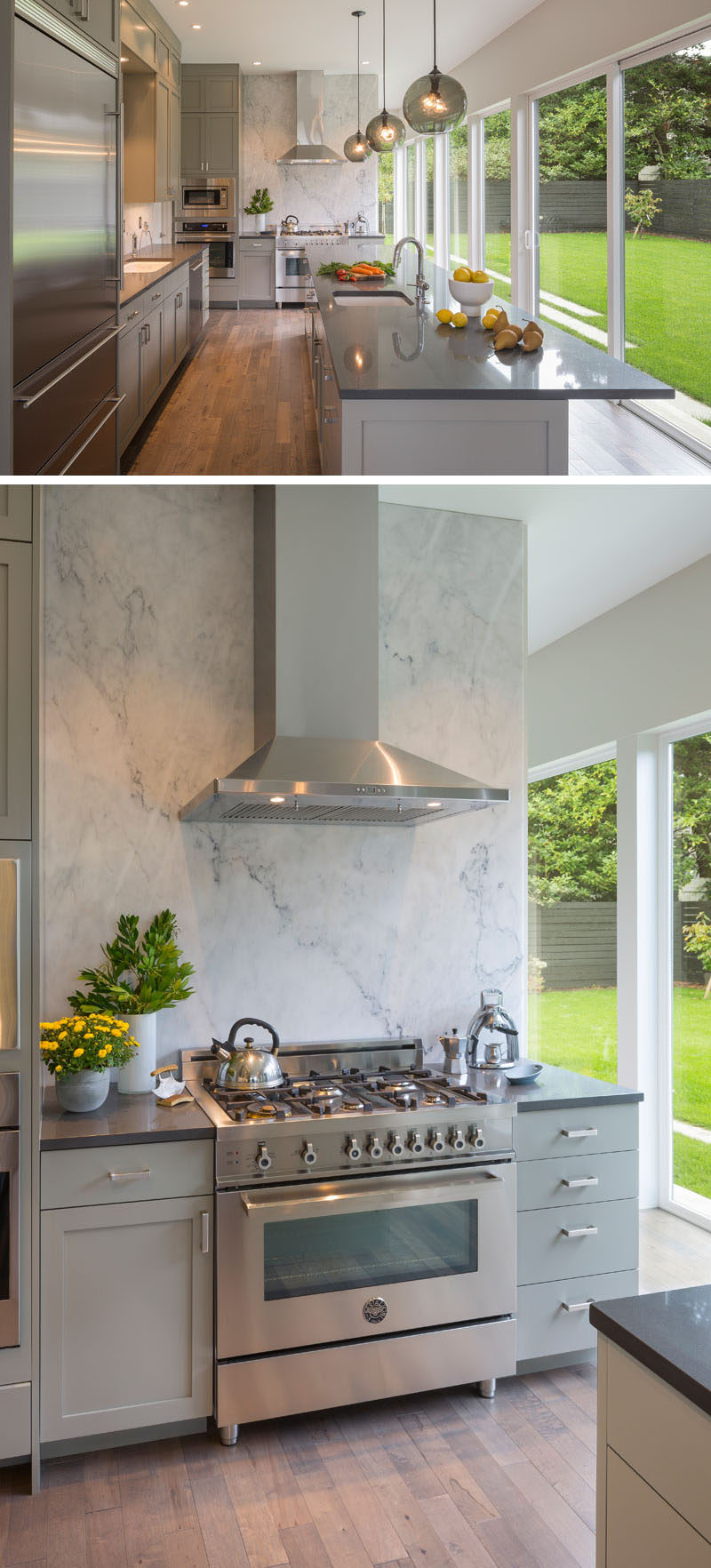 This contemporary kitchen features a large grey marble slab at the end of the kitchen is illuminated and becomes a backdrop that's visible from inside and out. A large kitchen island with a sink and plenty of storage, provides ample food prep space.