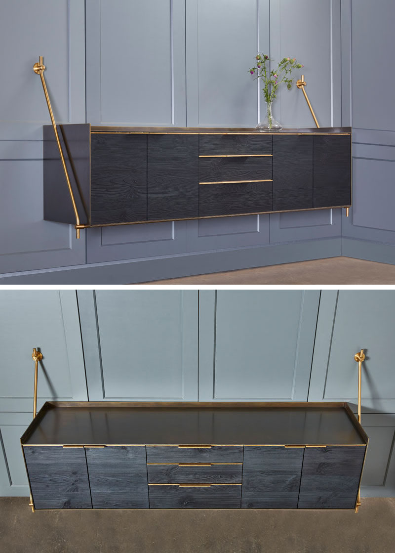 Amuneal have designed a wall hanging credenza that's made from a charred pine exterior wrapped in darkened brass with warm brass accents.