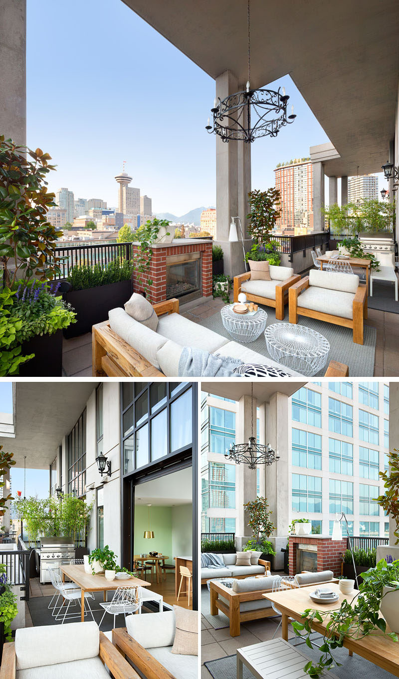 This modern loft balcony has views of downtown Vancouver, and is filled with a variety of places to relax or entertain. There's a bbq and outdoor dining area as well as a lounge area next to a fireplace.