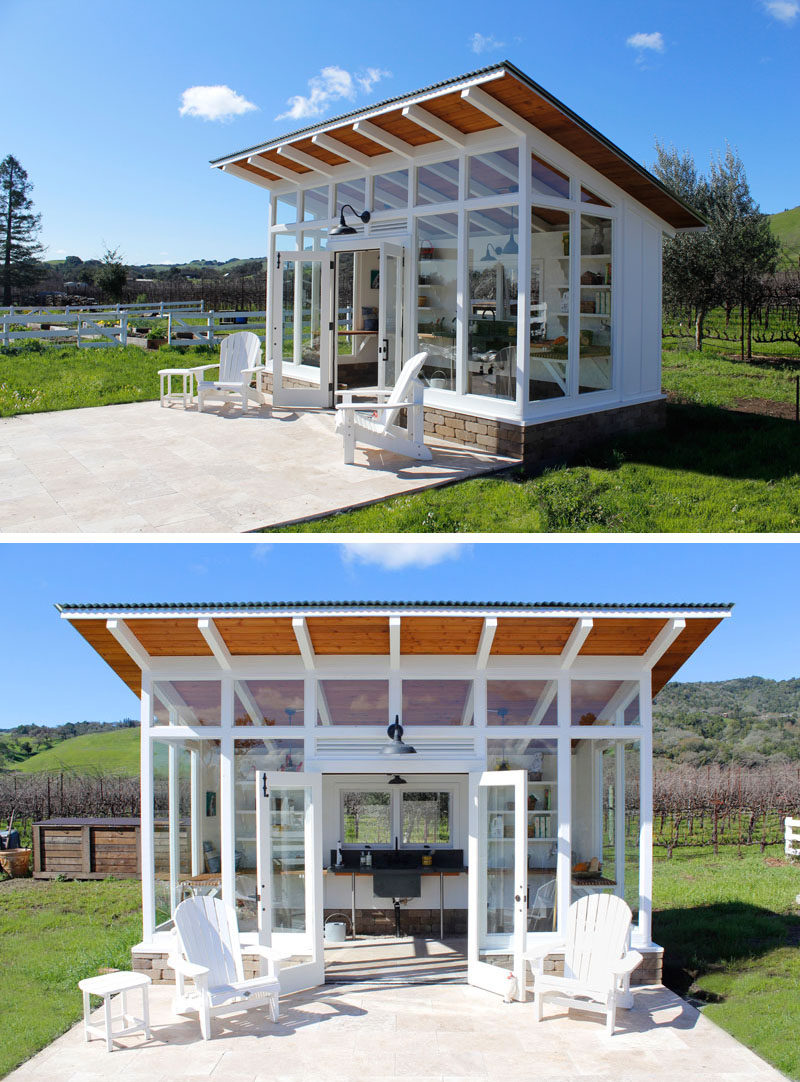 Robert Frear Architects have designed a small and modern potting shed with a sloped roof and lots of windows, that sits next to a garden with raised beds and a chicken coop on a property in Sonoma County, California.