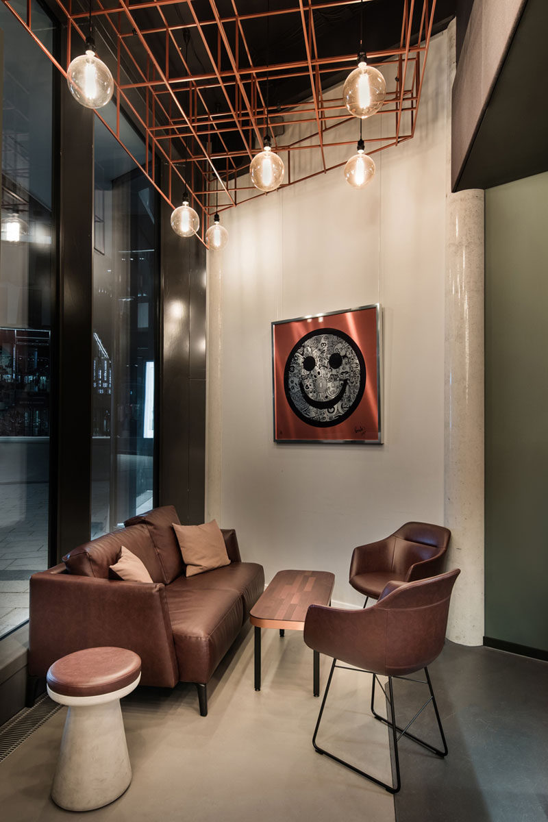 In this modern bar there's a small lounge area with a comfortable vintage sofa and armchairs.