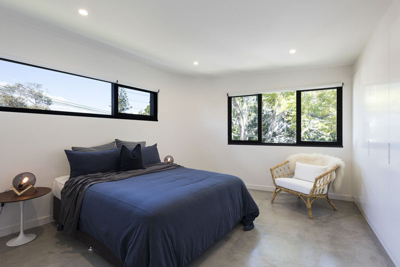 In this simple bedroom, furnishings have been kept minimal and glimpses of the sky and trees outside are visible through the black-framed windows. #Bedroom #Windows #Interiordesign