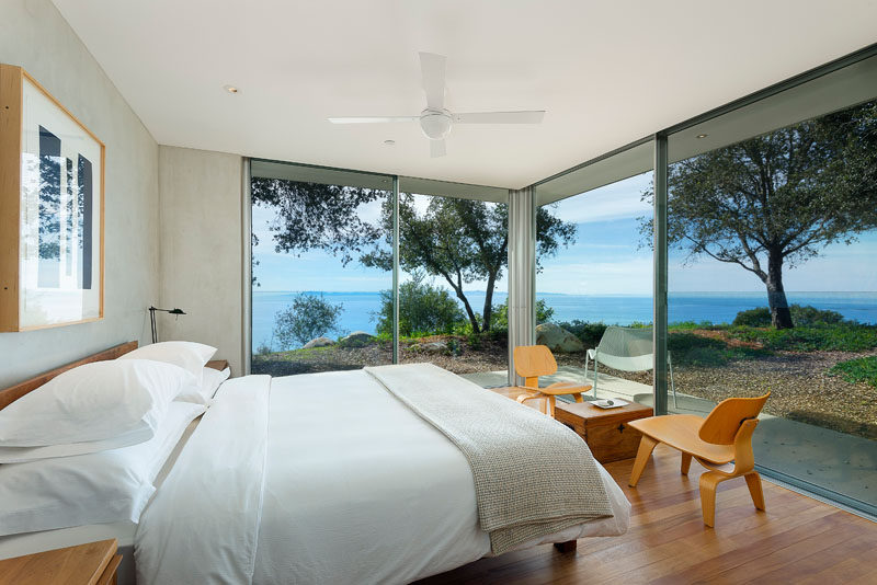 This modern bedroom has sliding glass walls that open it to the outdoors.