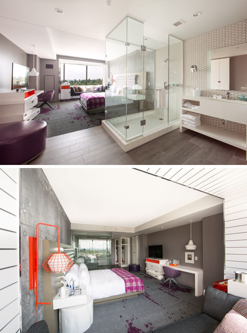 This modern hotel room features a glass shower in the middle of the room, defining the separate sleeping and bathroom areas, while in the sleeping area, 'wine spilt' carpets reflect the wineries of the region.