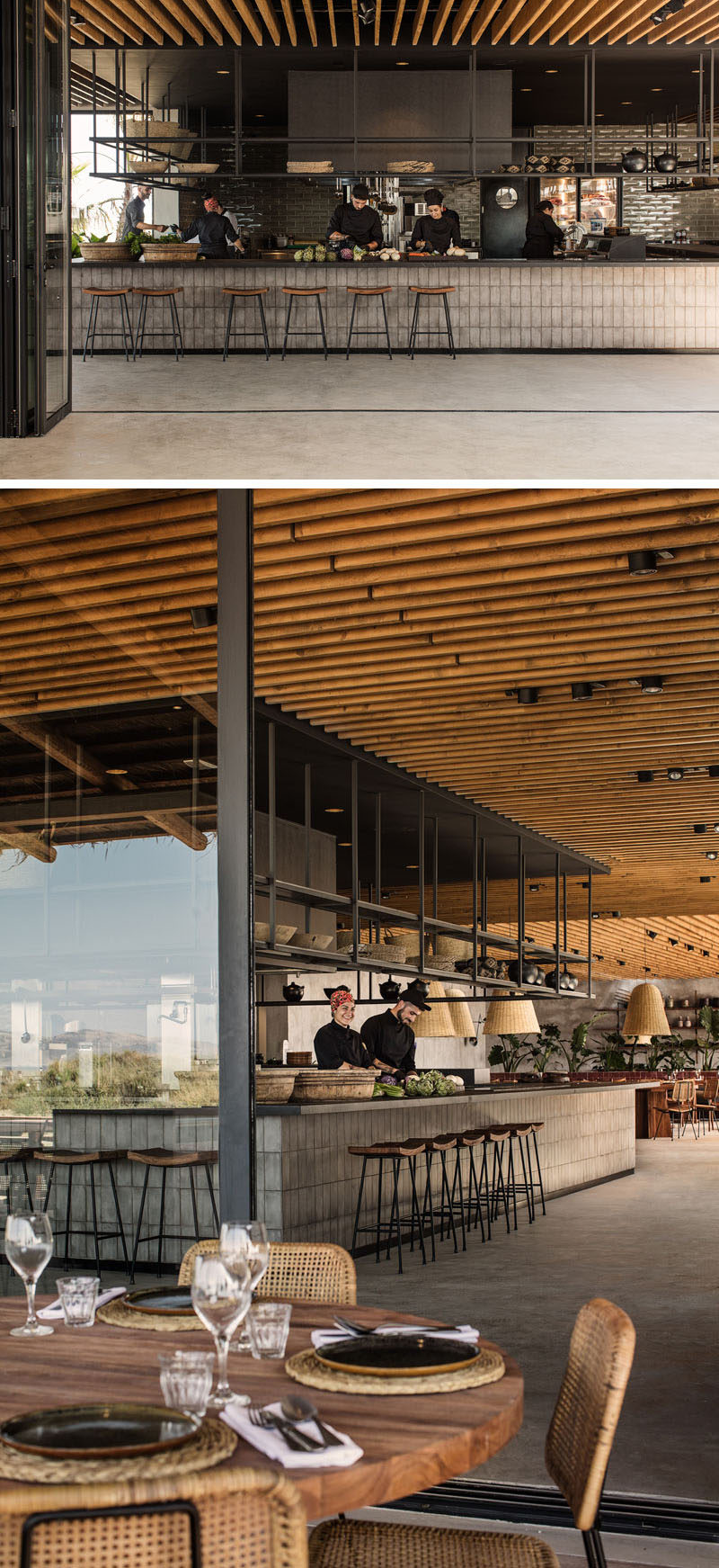 This hotel restaurant features an open-kitchen with black metal shelving that hangs from the ceiling. #Restaurant #RestaurantDesign #Hotel #InteriorDesign #Architecture