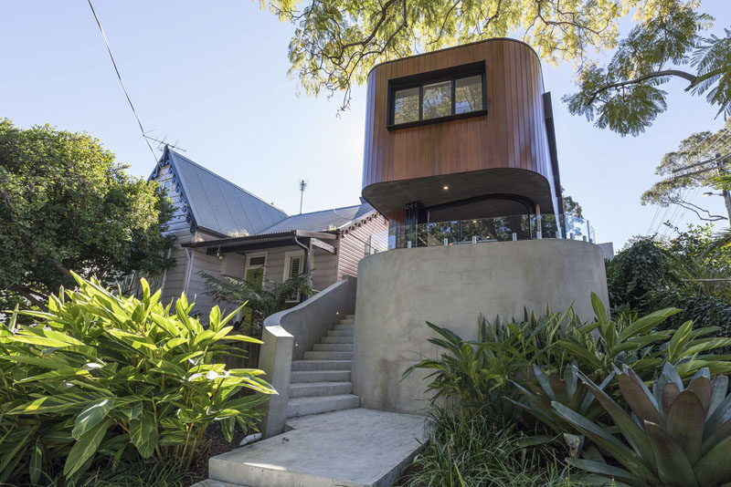 A Curved Wood And Concrete Exterior Greets Visitors To This Home In Sydney