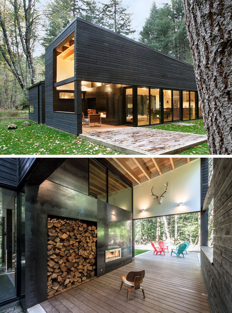 This modern house has a covered outdoor space that extends out into the backyard. A fireplace in the covered sections allows for entertaining in the cooler weather.