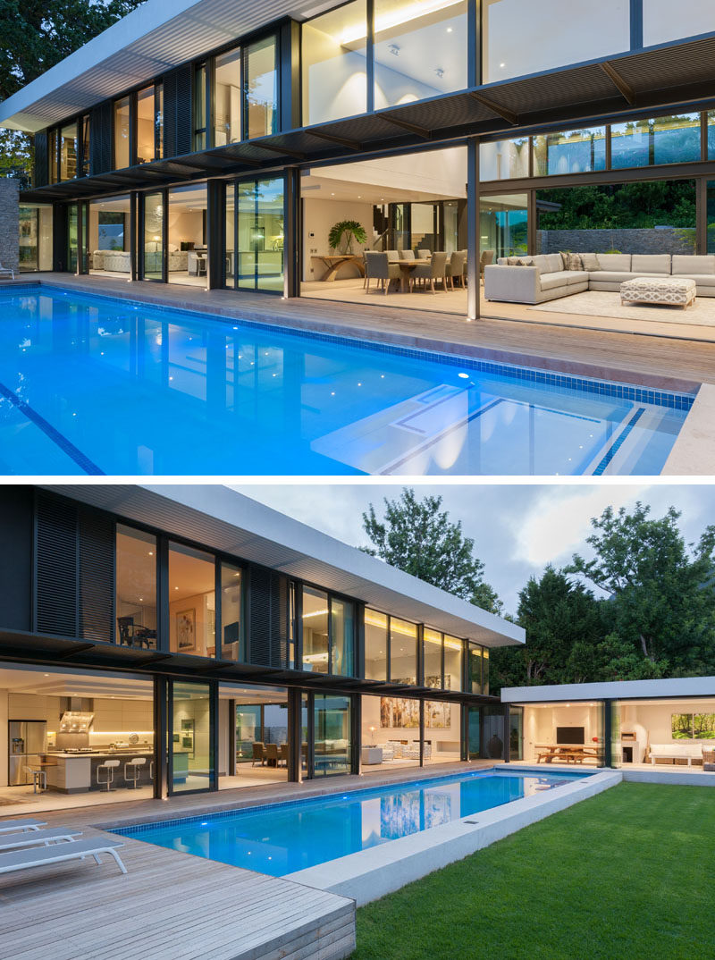 This modern house has been designed so that the main floor opens up to the swimming pool and deck.