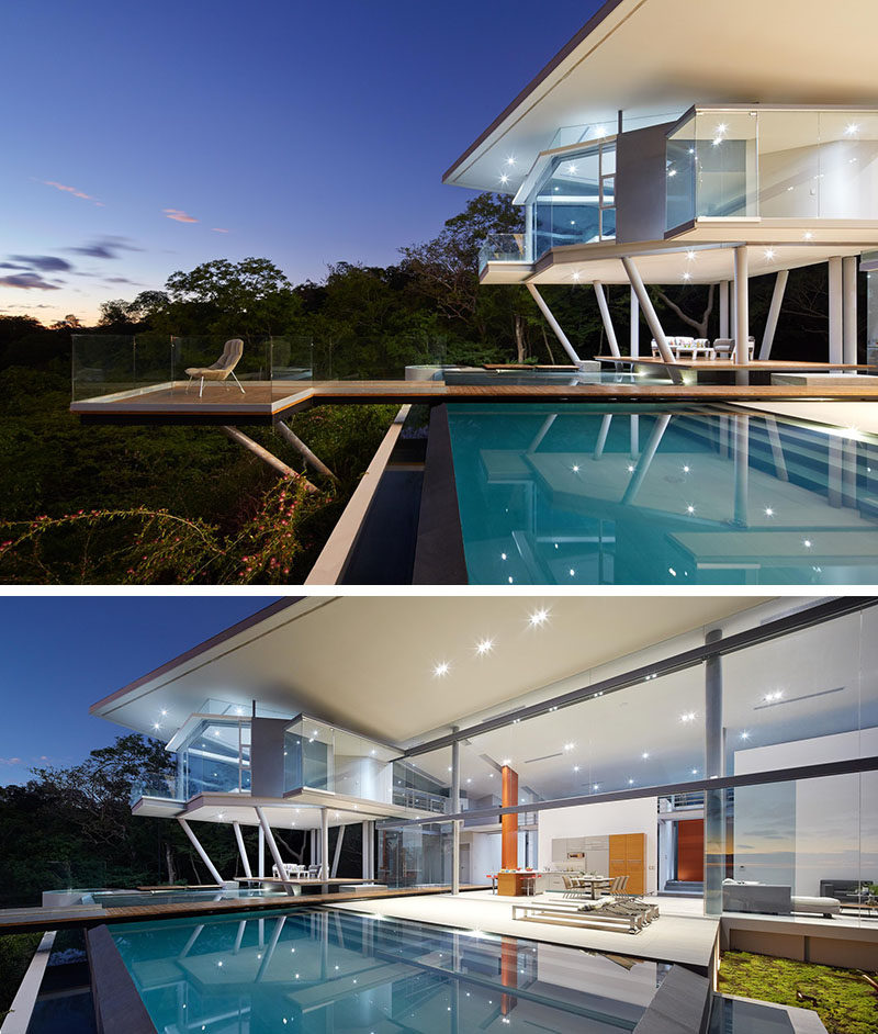 This modern house has a pool that merges with a terrace that surrounds an outside living room in its entirety, making the covered outdoor space like an island.