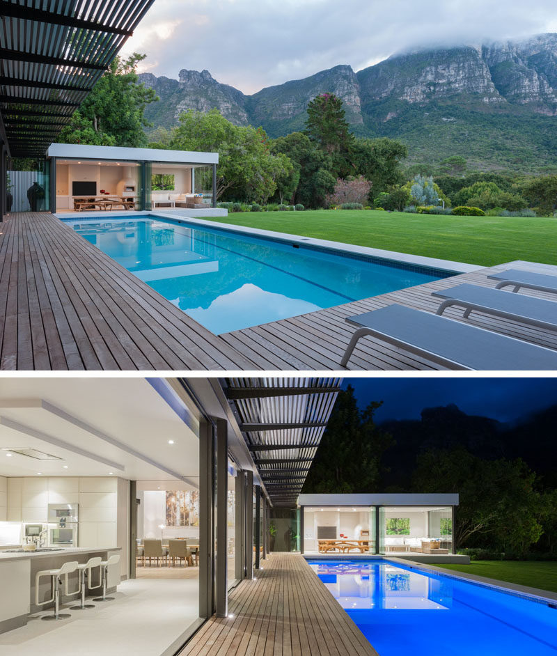 This modern house has expansive uninterrupted mountain views. At the end of the swimming pool is a small pavilion that houses a casual living room and dining area.