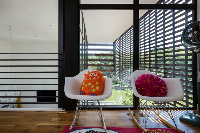 Colorful and fun cushions add a pop of color to white chairs.