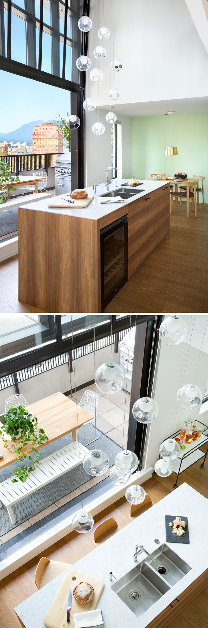 This modern kitchen island has a built-in wine fridge, undermount sinks, storage, and the countertop overhangs slightly on one side to enable people to sit at the counter.