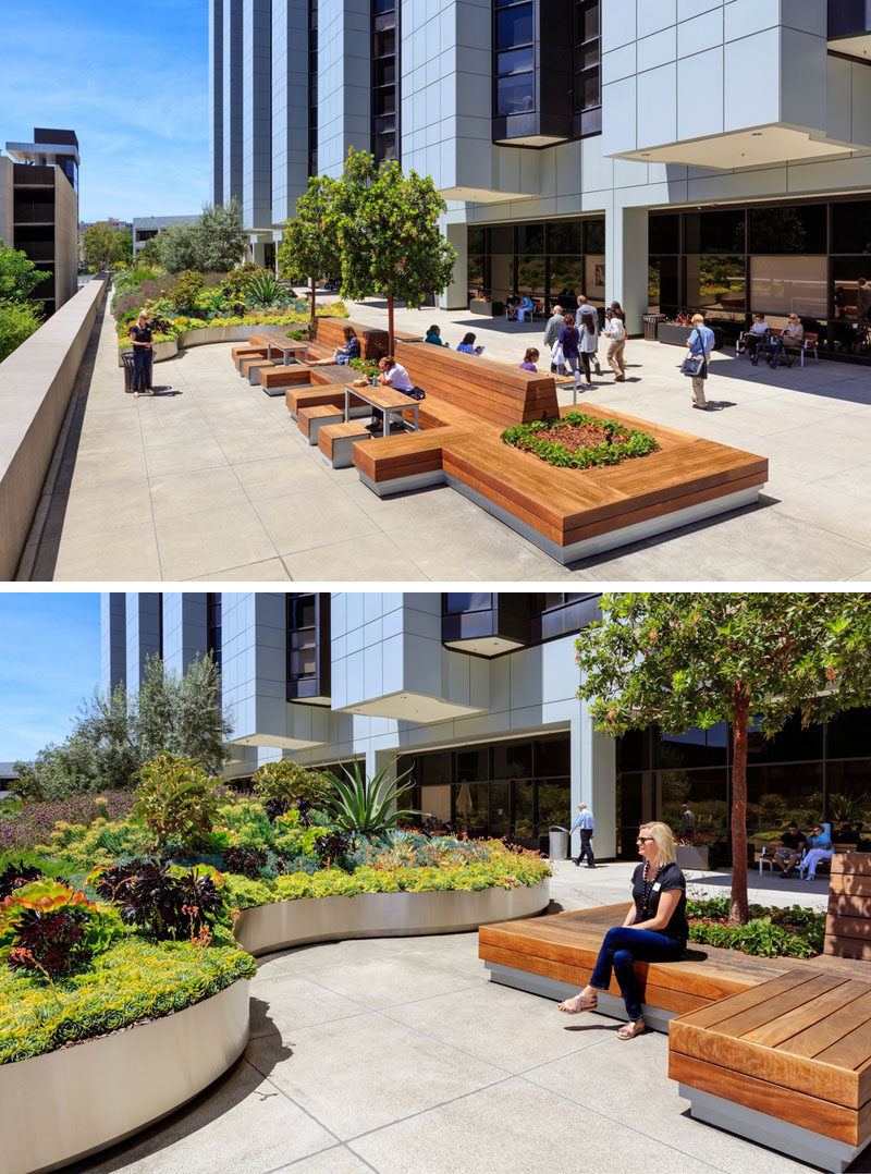 This healing garden at a medical center has wood benches with built-in planters allowing for communal seating and places for employees to have their break.