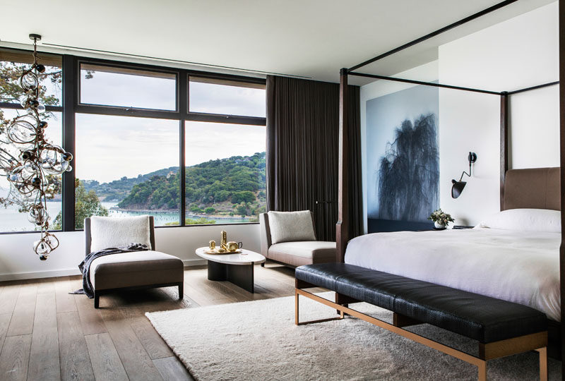 Large windows and an area for lounging makes this modern master bedroom perfect for relaxing.