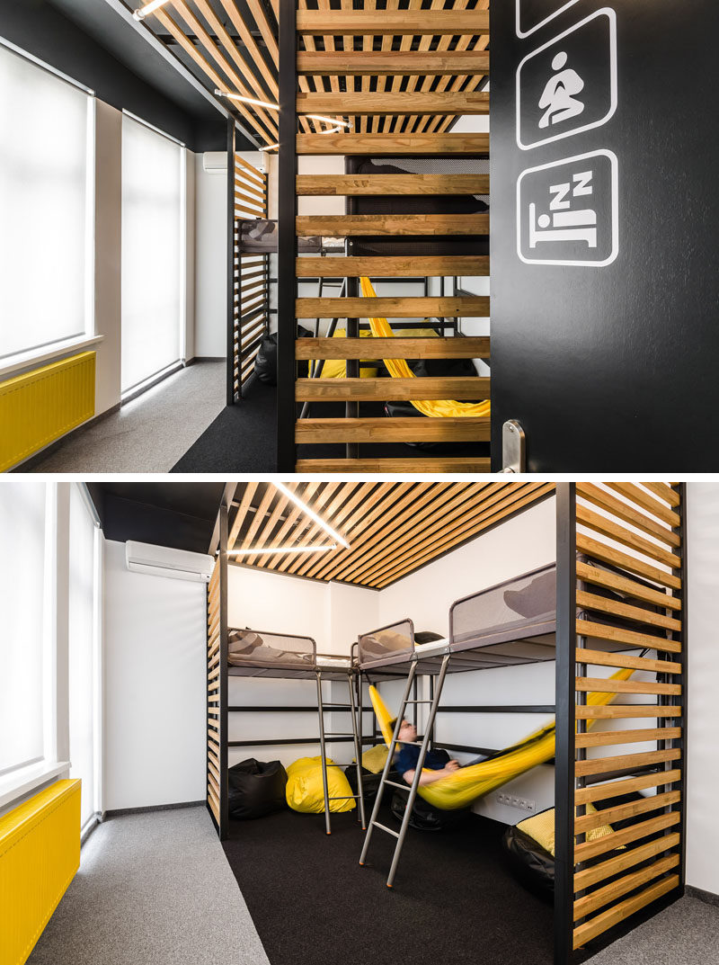 This modern office interior has a nap room where employees can take a quick rest in one of the beds or in the hammock. There's also a few bean bag chairs to relax and have some quiet time.