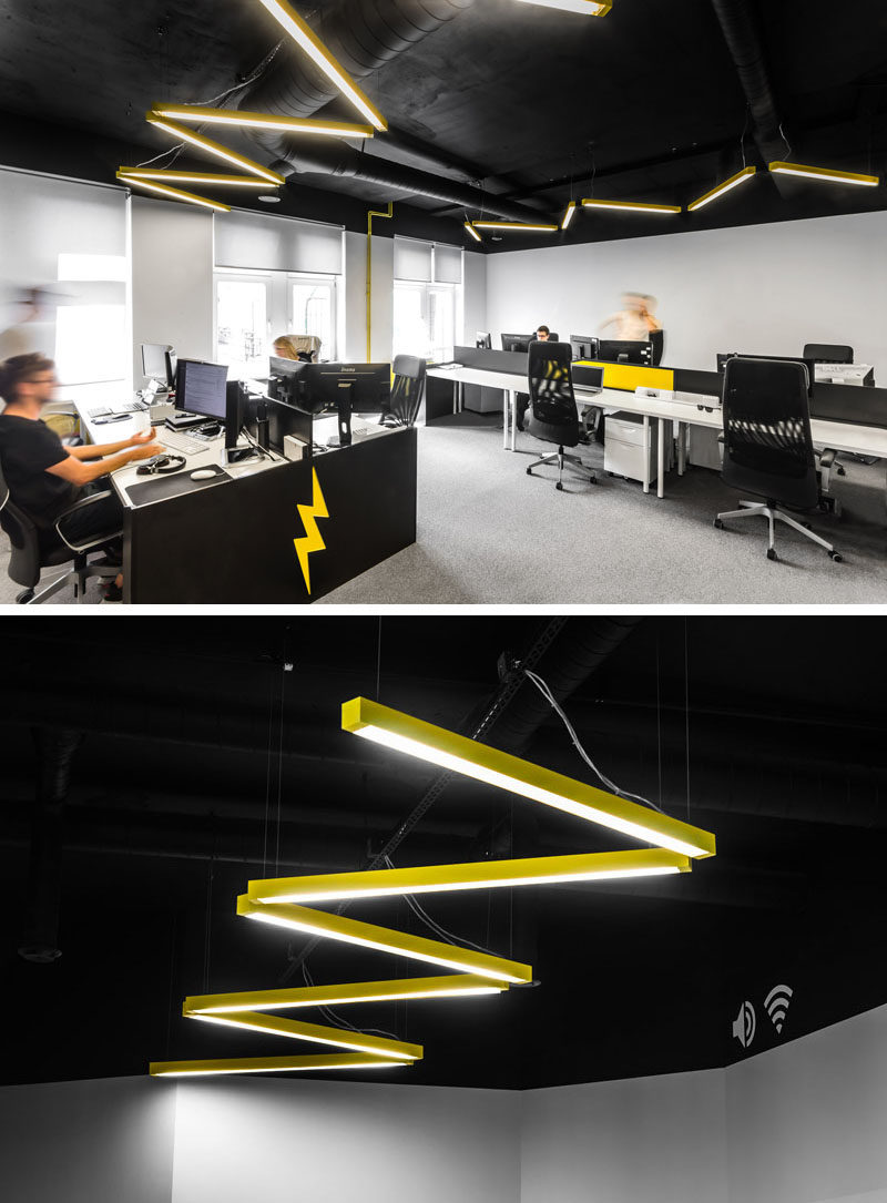 In this modern open plan work area, there's yellow lighting arranged in a zig-zag form that's a reference to the lightning bolt found in the company's logo.