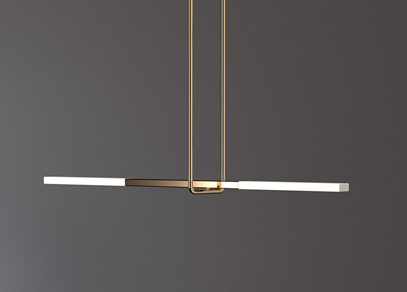 Design studio Porcelain Bear, have created the Acrobat pendant light collection, that's a series of modern lights that have illuminated translucent porcelain arms supported by a suspended minimalist trapeze, much like when an acrobat is performing.