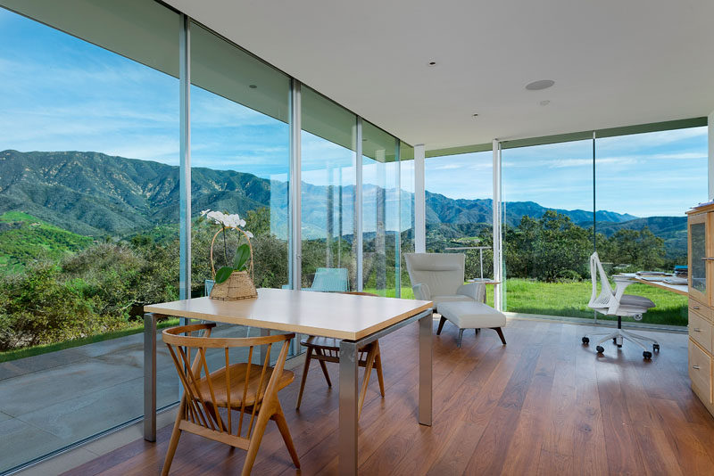 Views of the surrounding mountains are a natural backdrop for this modern home office.