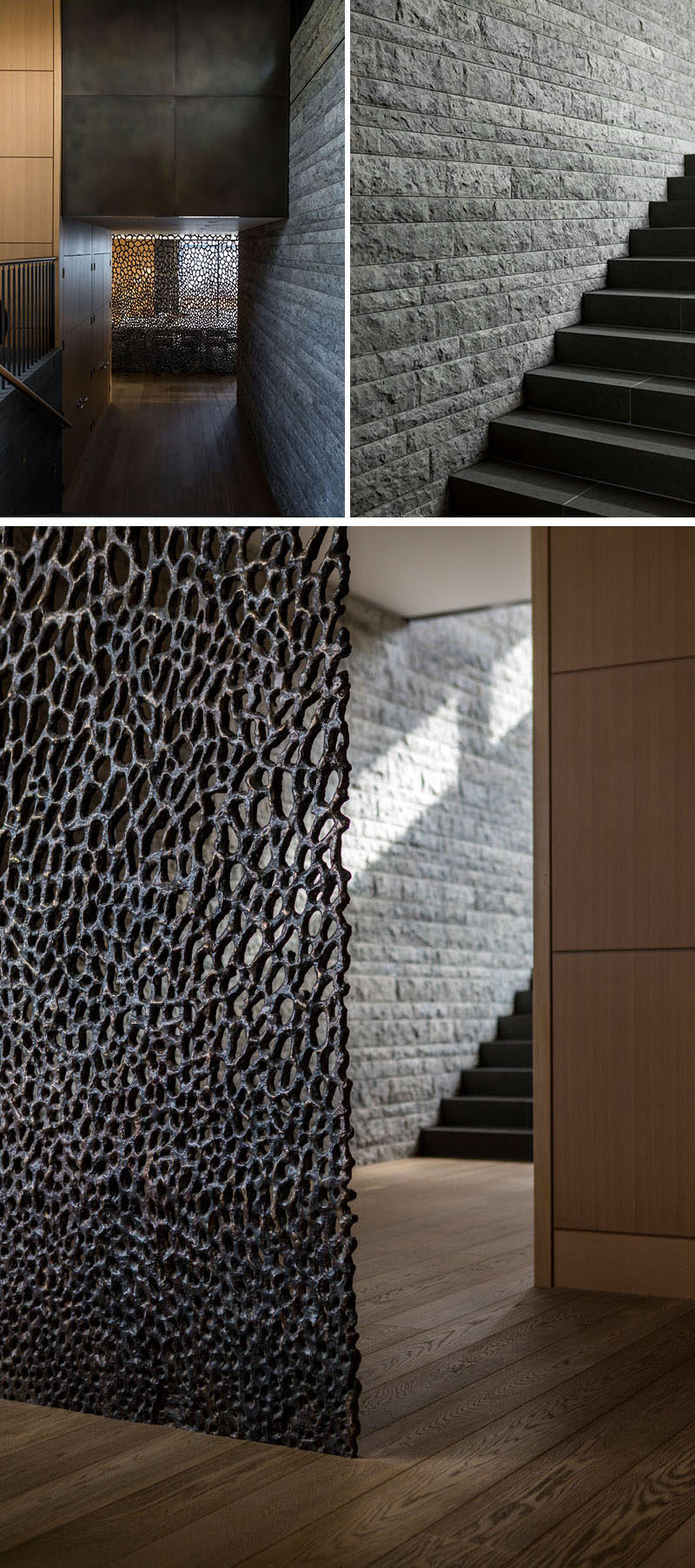 In this modern house, a stone wall runs alongside the stairs, while at the bottom of the stairs, there's a decorative screen hiding the dining room.