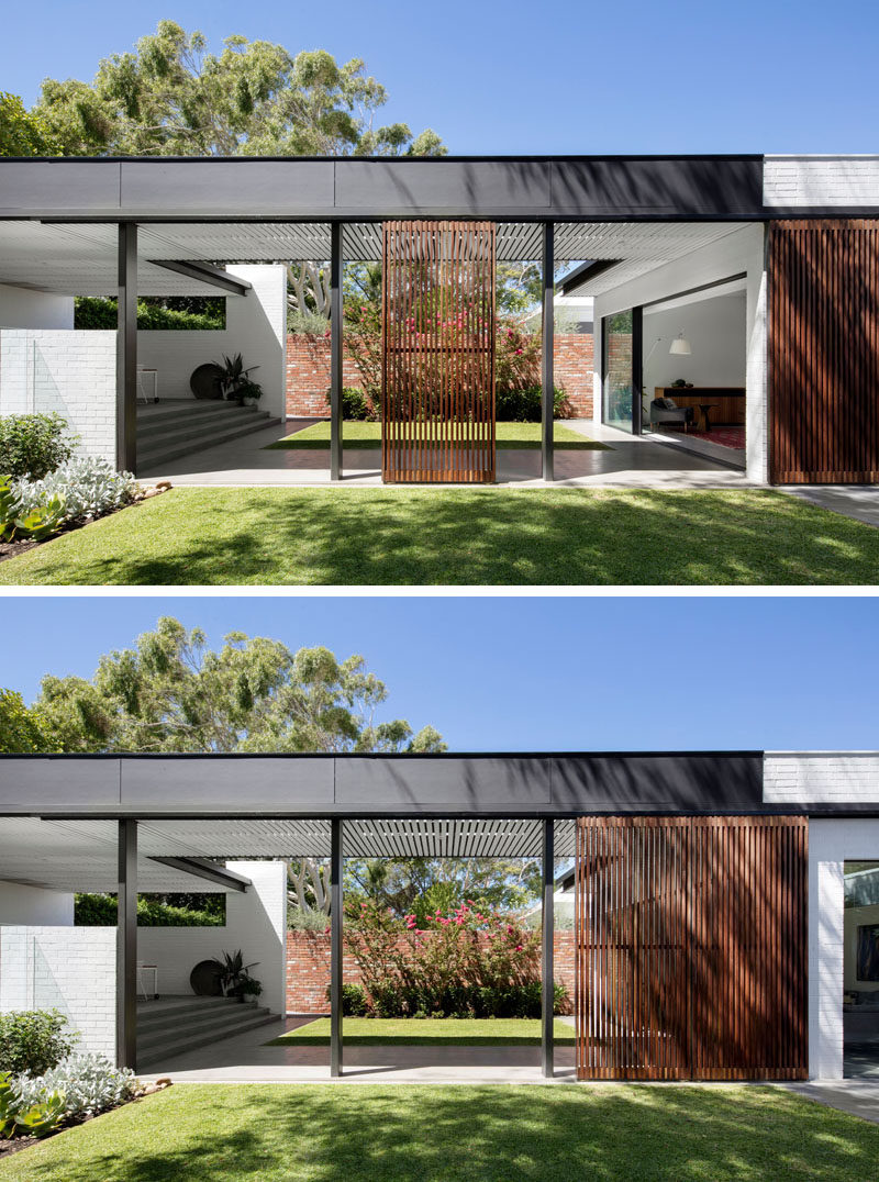 A covered walkway connects this house to the various areas of the new backyard, while operable timber screens have been included to provide shade when needed.