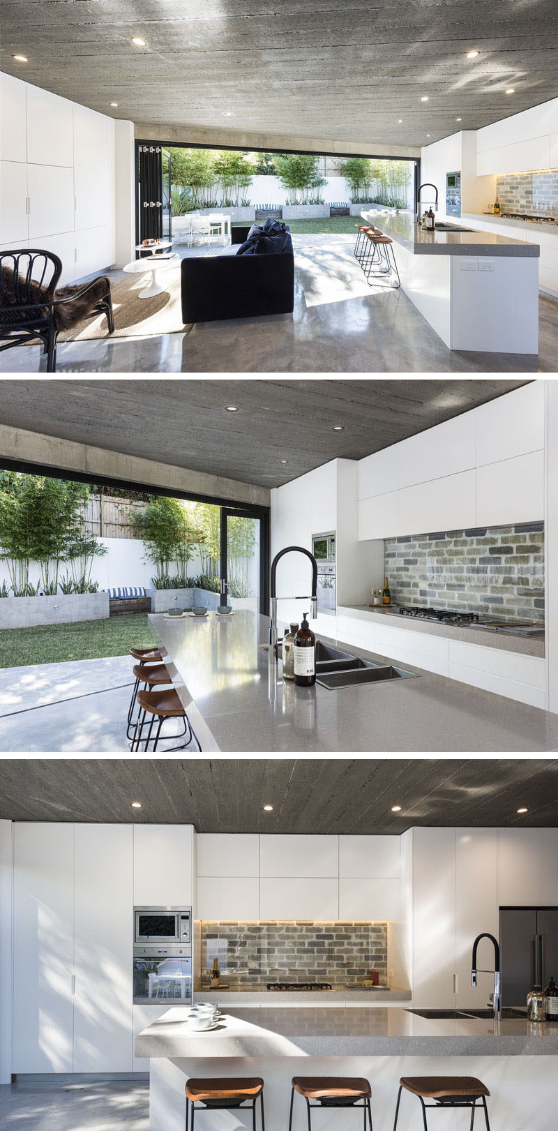 The interior of this modern house is bright and open, with the living room and kitchen sharing the same space. Minimalist white cabinets are featured on both walls, and in the kitchen a brick backsplash covered by glass has been used to create a unique accent. #ModernKitchen #WhiteCabinets #BrickBacksplash #ModernLivingRoom #OpenPlanInterior