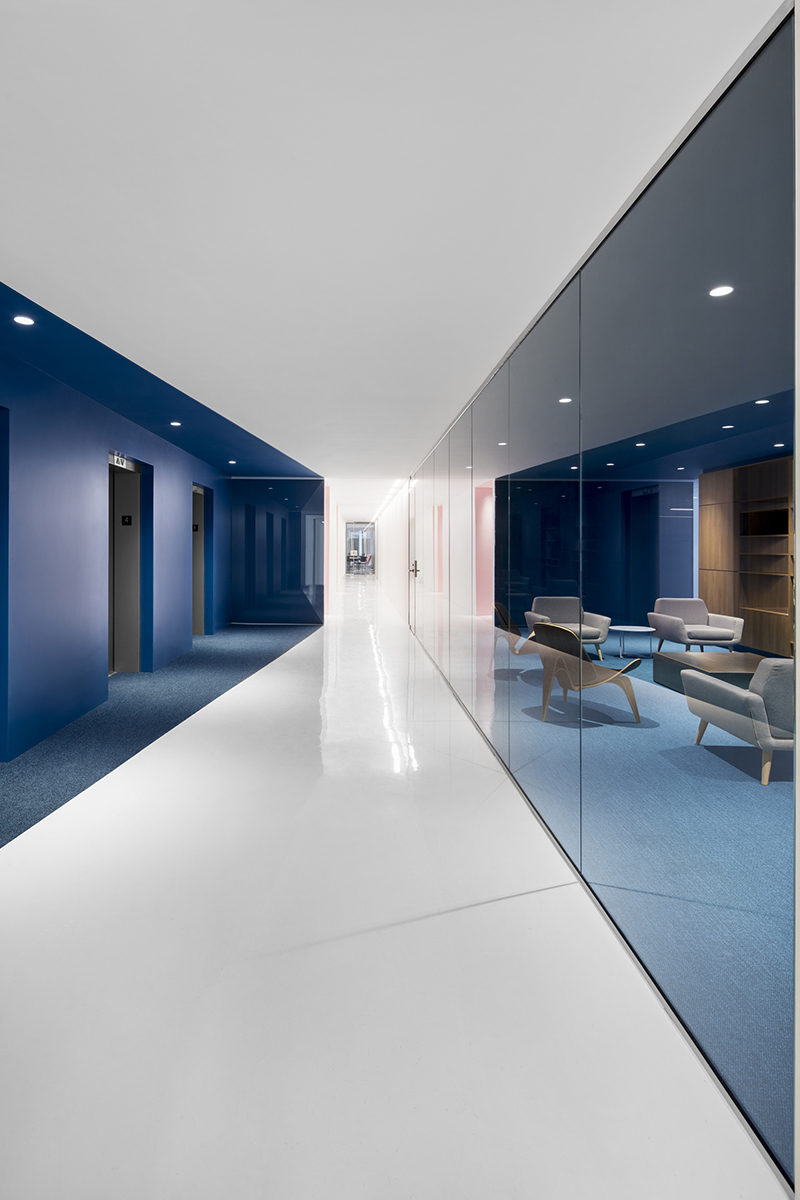 This office interior used color to create distinct spaces for Various architectural concepts